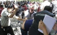Неизвестные охранники избили активиста оппозиции