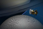 Станция Cassini сделала снимок Дионы на фоне Энцелада