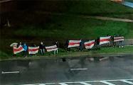 В Гродно прошло шествие под бело-красно-белыми флагами