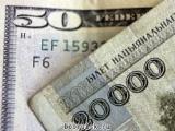 Курс белорусского рубля снизился по отношению к трем валютам