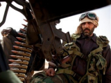 Каддафи бросил против мятежного города танки и авиацию
