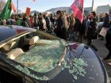 Антиглобалисты в Женеве сожгли несколько машин