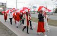 Минчанин начал утро с пробежки, посвященной девушкам с бело-красно-белыми зонтами