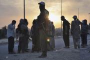 СМИ сообщили о показательной казни 20 боевиков ИГ за дезертирство